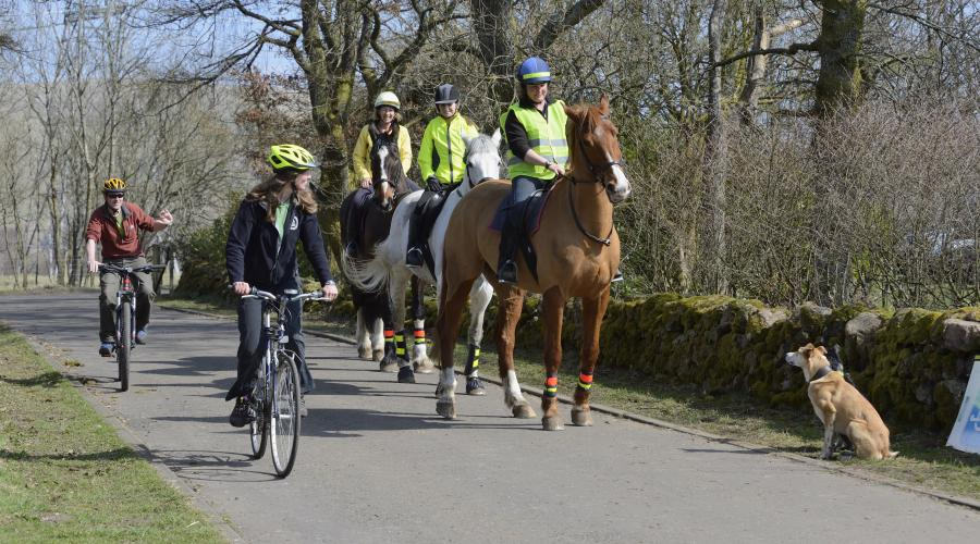 Horse riders and cyclists at Mugdock Country Park near Glasgow. April 2015. ©Lorne Gill/SNH. For information on reproduction rights contact the Scottish Natural Heritage Image Library on Tel. 01738 444177 or www.nature.scot