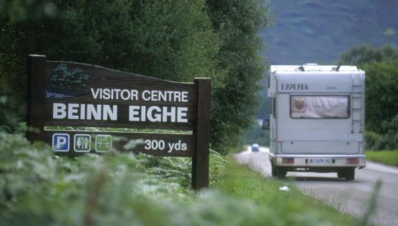 Summer. Campervan on main road and SNH Beinn Eighe Visitor Centre signage. Beinn Eighe NNR. Wester Ross. ©John MacPherson/SNH